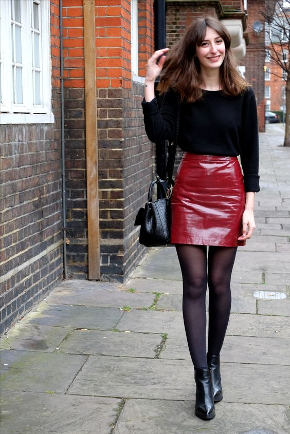 a black long sleeve top, a red leather mini skirt and black booties for a sexy look