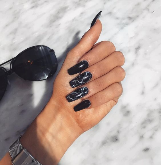long black nails plus two black marble accent ones are very edgy