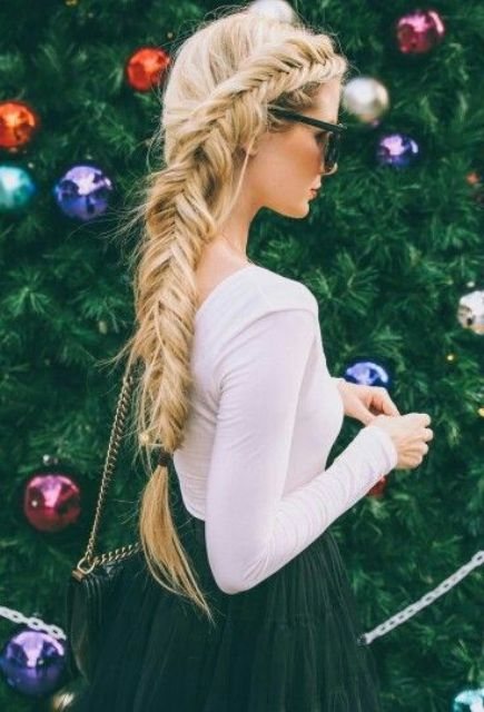a large side fishtail braid is all you need for an eye-catchy look
