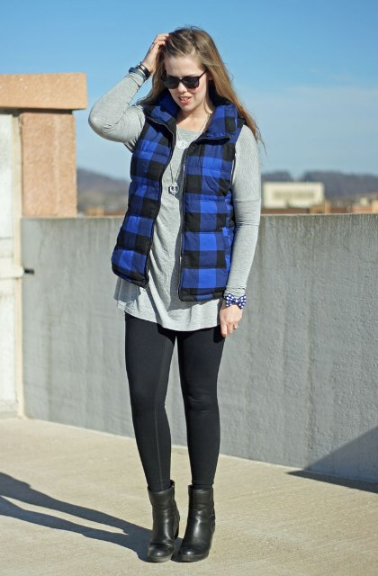 With gray loose shirt, black leggings and heeled boots