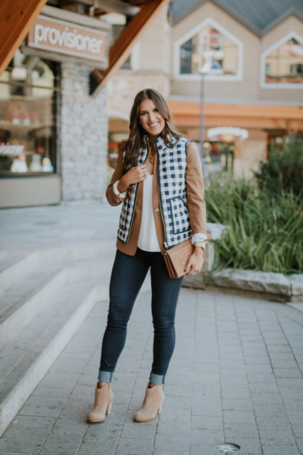 With white blouse, camel jacket, cuffed jeans, beige ankle boots and clutch