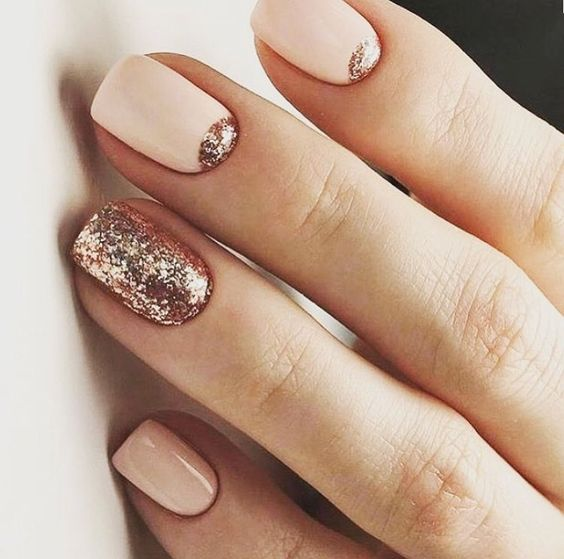 blush nails with rose gold half moons and a whole rose gold accent nail for a girlish look