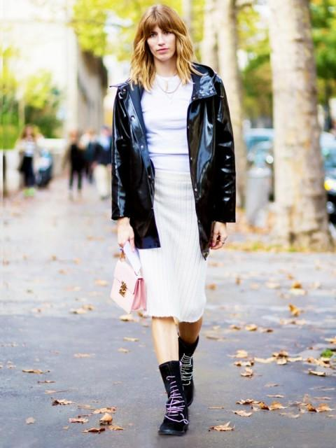 With white shirt, beige skirt, pale pink bag and boots