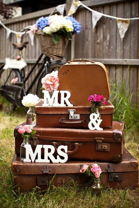 vintage leather suitcases, monograms and blooms for vintage wedding decor