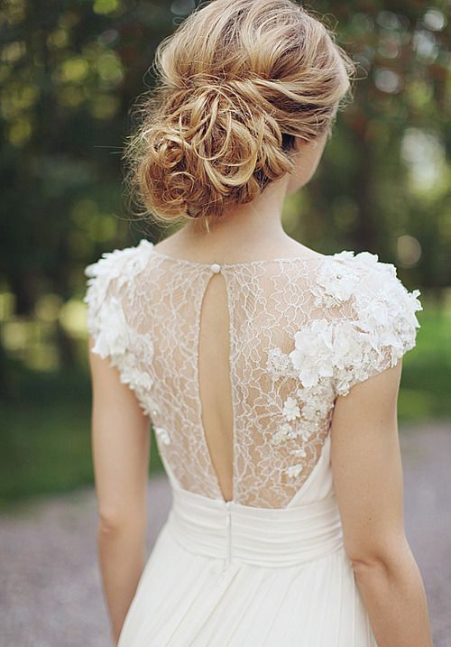 an ethereal sheer lace back with lace appliques and a cutout