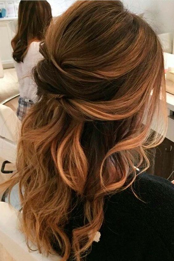 a wavy half updo with several twists looks sexy and chic