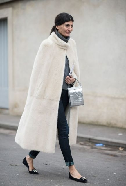 With gray turtleneck sweater, cuffed jeans, black flats and metallic bag