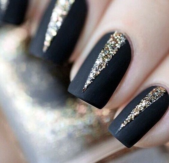 matte black nails with gold glitter geometric detailing with a wow factor