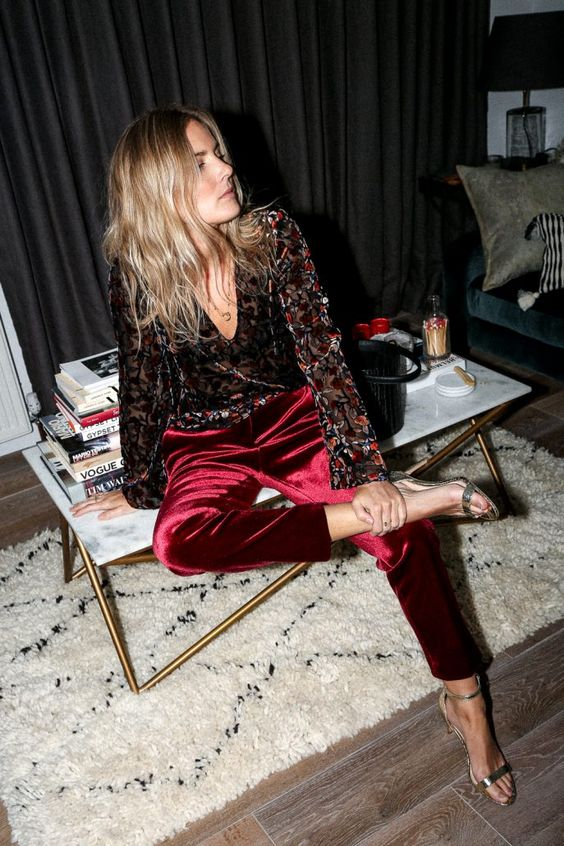 burgundy velvet pants, a vintage-inspired floral blouse and metallic shoes