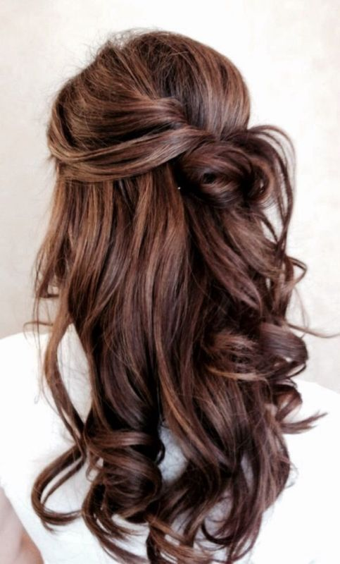 a twisted and wavy half updo with a bun is a simple hairstyle to make