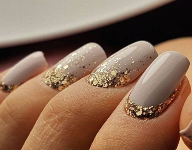 dove grey nails with large scale gold glitter at the base