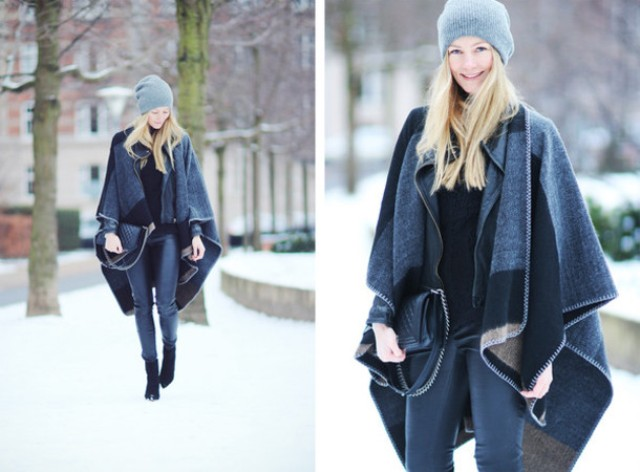 With black shirt, leather pants, gray beanie and clutch