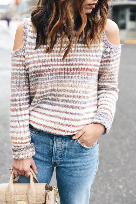 blue jeans and a striped cutout sweater for a cozy and cute look