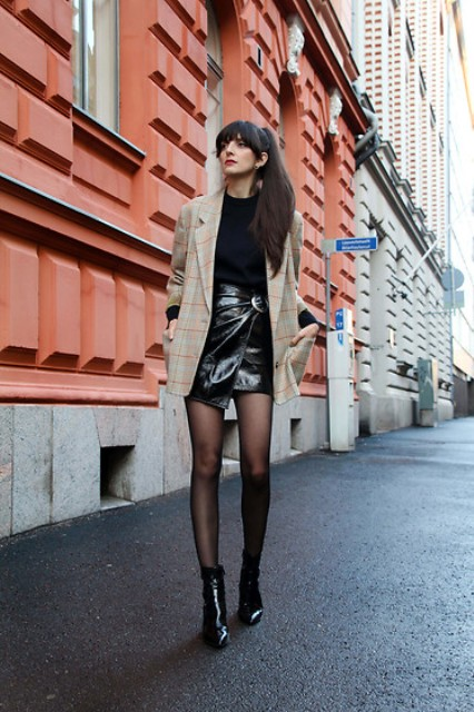 With black shirt, printed long blazer and black leather boots
