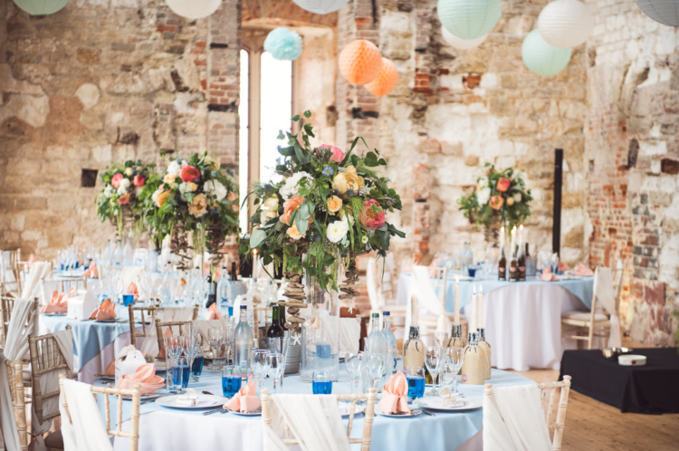 The wedding centerpieces were colorful floral ones, with paper lanterns around