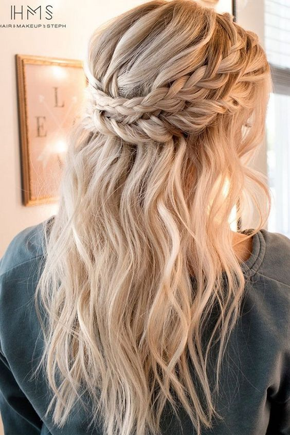a half updo with a double braid and beachy waves looks chic and cute