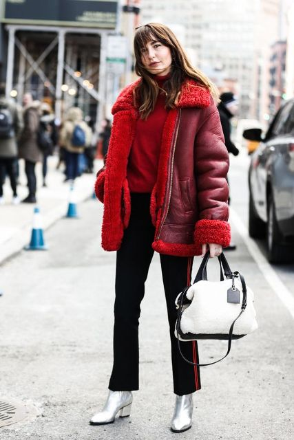 With red turtleneck, shearling jacket, flare trousers and black and white bag