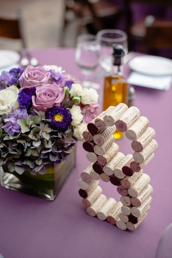 a floral centerpiece in pink, white and violet for an eye-catchy and chic look