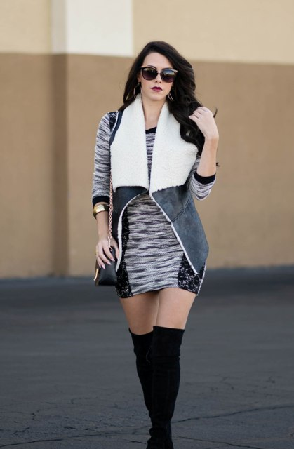 With printed mini dress, black over the knee boots and chain strap bag