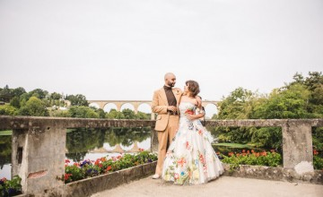 This couple got married in a French fort, with a floral wedding dress and lots of blooms from the whole neighborhood