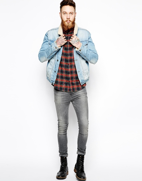 With plaid shirt, skinny jeans and black boots