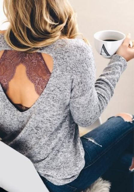 ripped blue denim, a grey cutout sweater and a dusty pink bralette