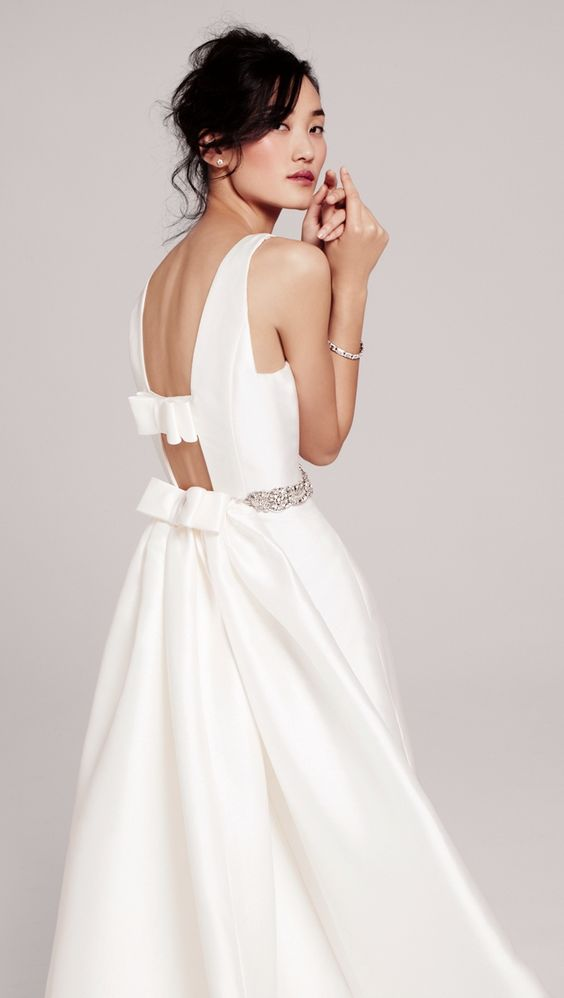 a cutout back with bow detailing makes this dress special and adds a playful touch