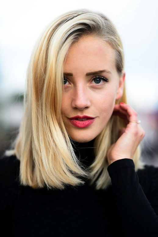 a blunt long bob and a subtle red lip are ideal for holidays