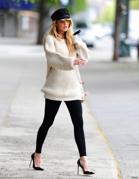 With white oversized sweater, leggings and pumps