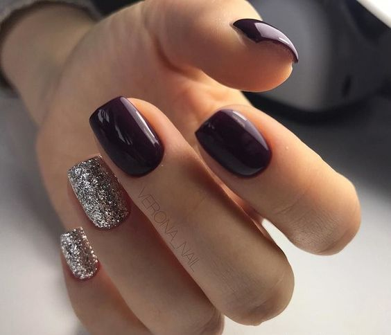 purple nails with metallic glitter accent ones look very chic and bold