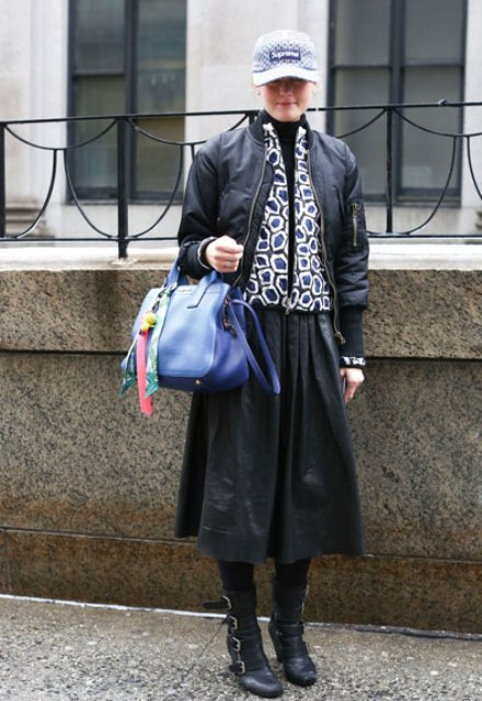 With black jacket, printed jacket, midi skirt, mid calf boots and blue bag