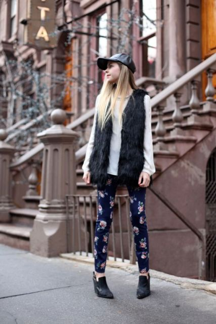 With white shirt, black fur vest, floral pants and ankle boots