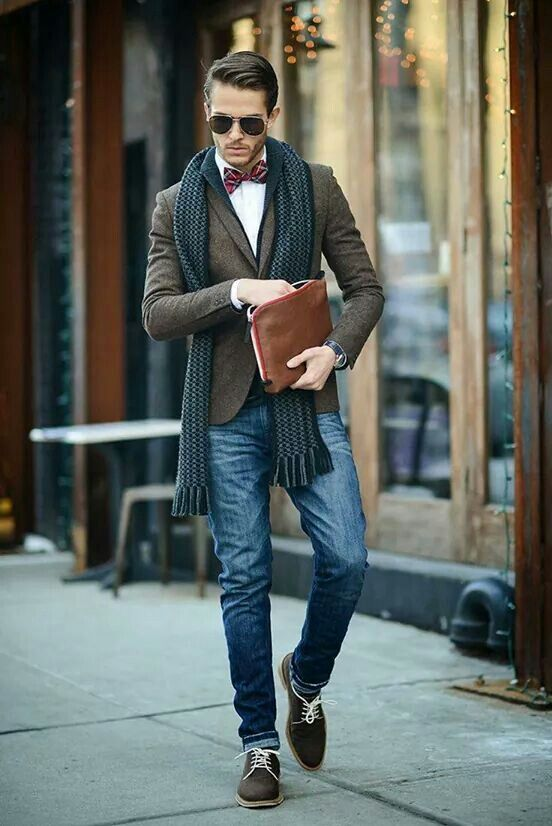 blue denim, a tweed jacket, an emerald scarf, brown shoes and plaid bow tie