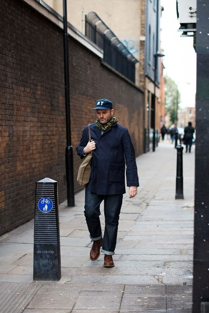 With printed scarf, navy blue jacket, cuffed jeans and brown shoes