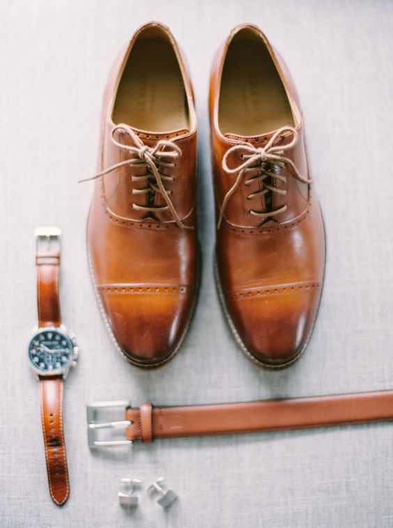 brown leather groom's accessories - a watch, a belt and shoes for a stylish look
