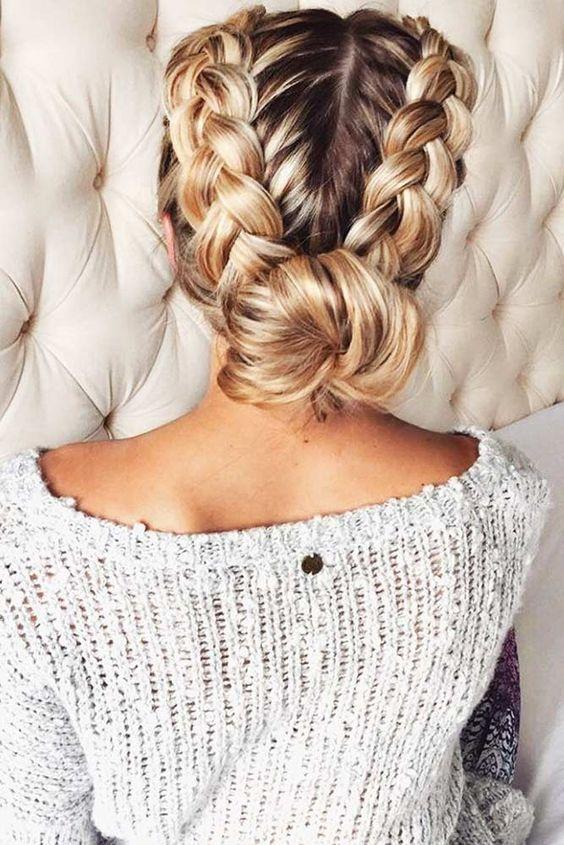 a comfy updo with two braids and a low bun looks cute and casual