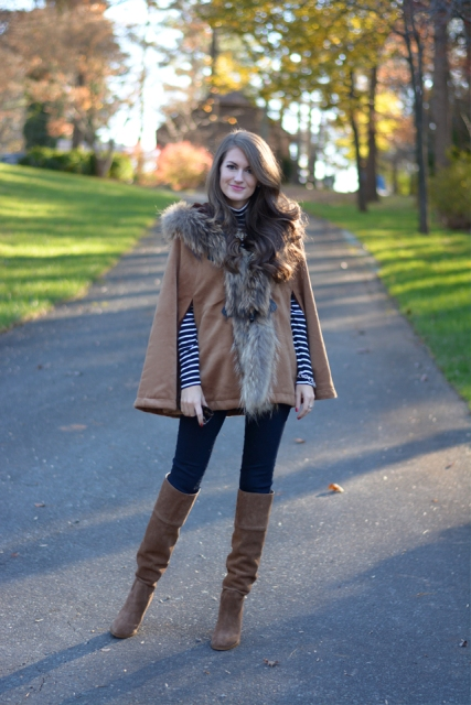 With striped shirt, jeans and suede over the knee boots