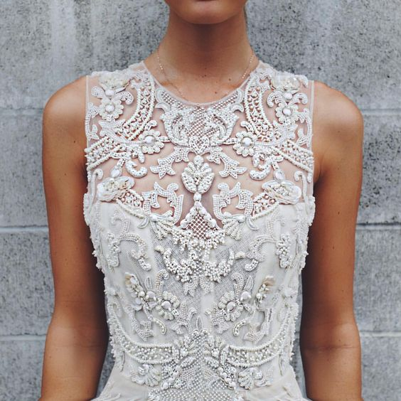 a heavily embellished illusion sweetheart neckline bodice looks royal