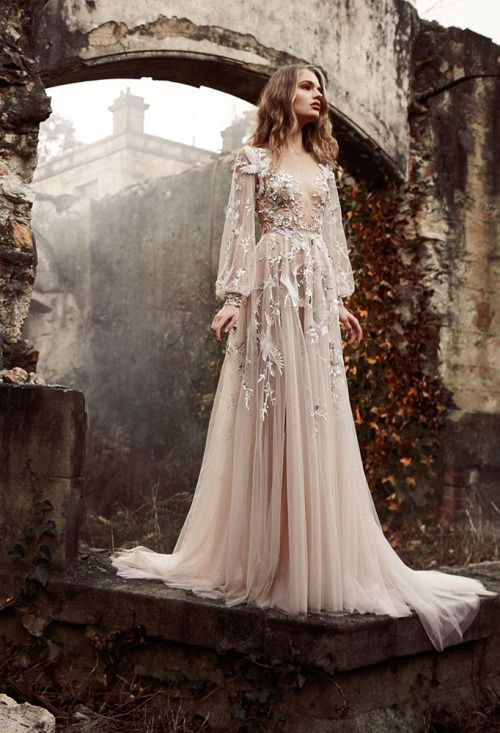a champagne wedding gown with long bell sleeves, a scoop neckline and floral lace appliques all over