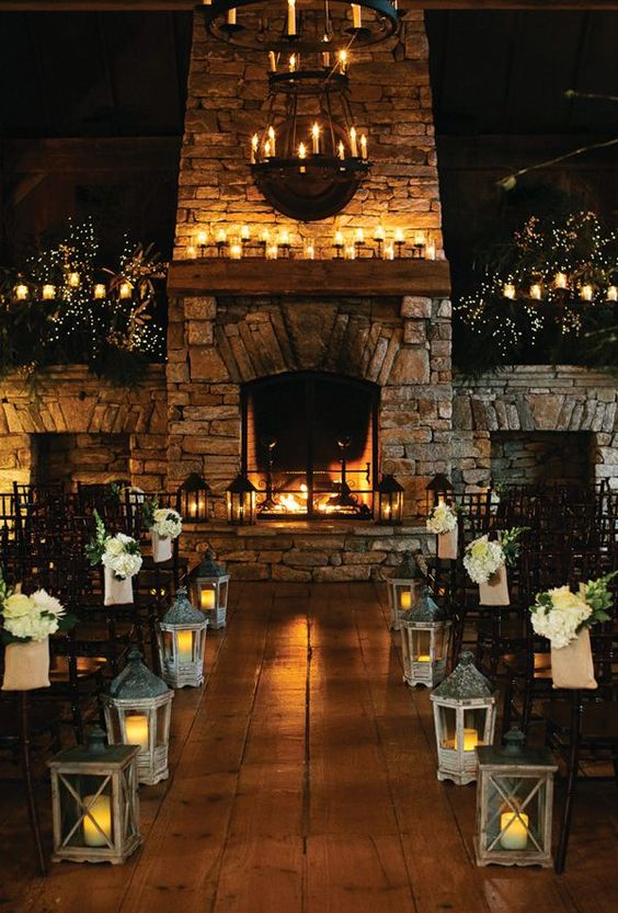 candle lanterns, candles in candle holders and the fireplace itself for an intimate feel during the ceremony