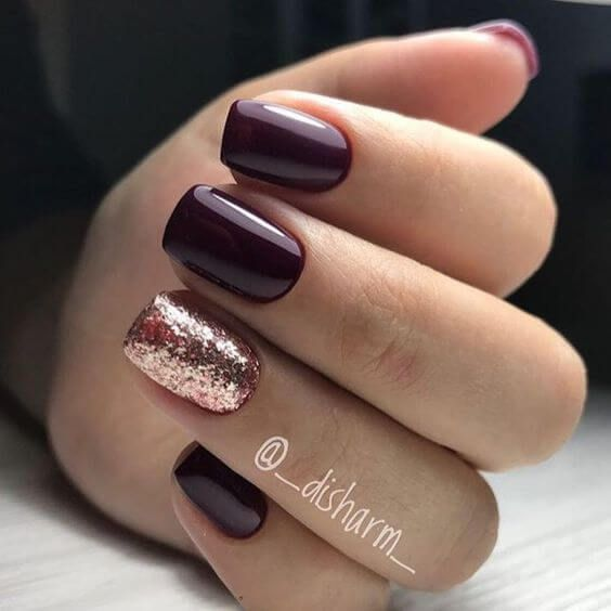 burgundy nails and an accent rose gold glitter one for a festive eel