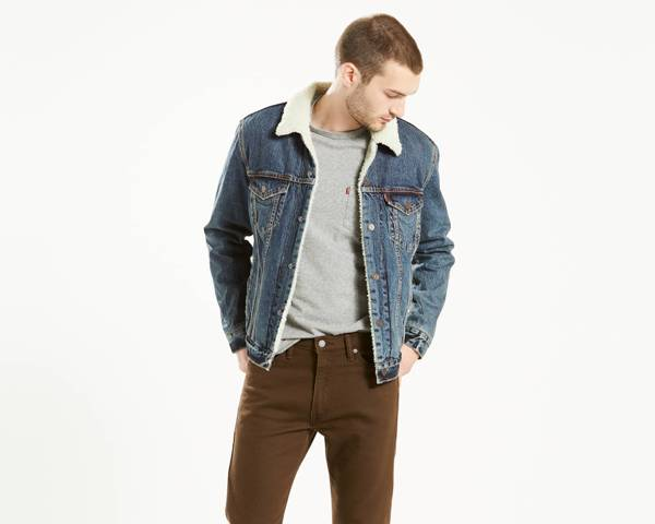With light gray shirt and brown jeans