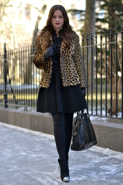 With black dress, black tights, ankle boots and tote