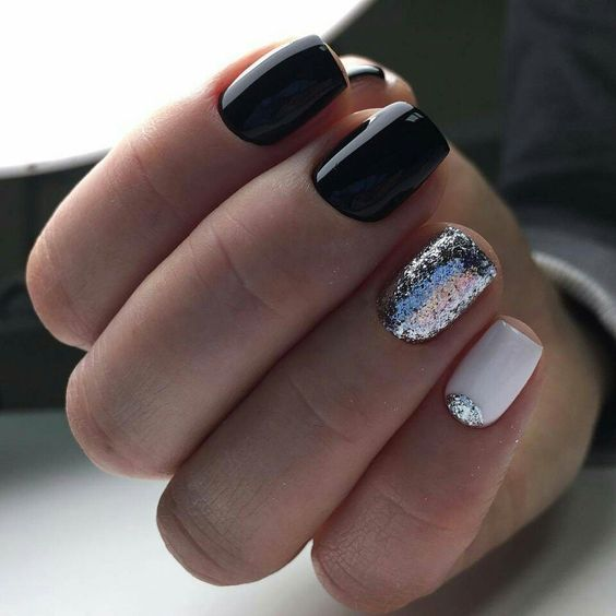 black and white nails with a silver glitter nail and a silver half moon touch