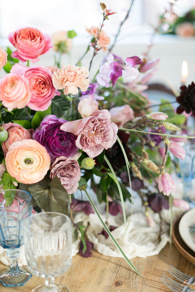 Purple, peach, lavender, and pink centerpieces