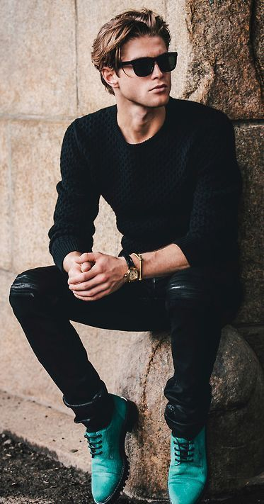 a black textural sweater, black ripped denim and bold mint boots for a colroful accent