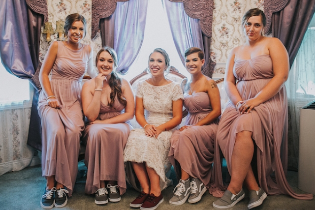 The bridesmaids were rocking mismatching dusty pink dresses and sneakers