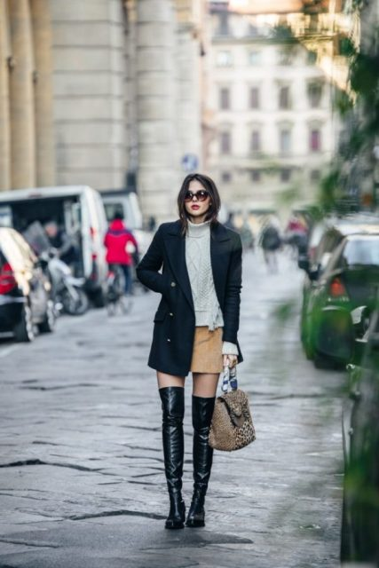 With white turtleneck sweater, mini skirt and coat