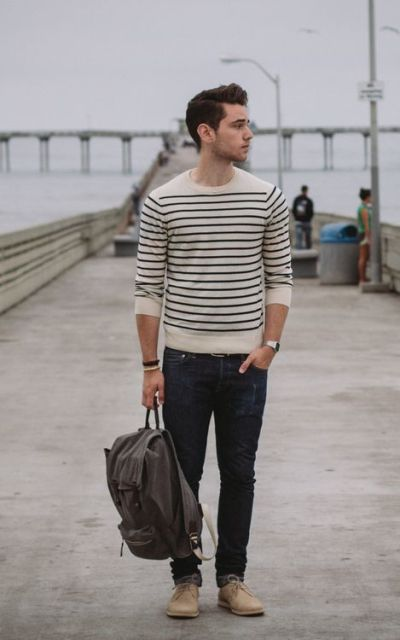 With striped sweater, jeans and gray backpack