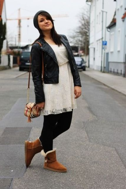 With white dress, black leather jacket, black tights and printed mini bag